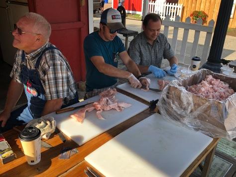 Joe Scott (left) and his crew slicing the pork fat